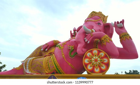 Pink Ganesha statue is very big lying on side on pedestal at Wat Saman Rattanaram temple, chachoengsao province ,Thailand