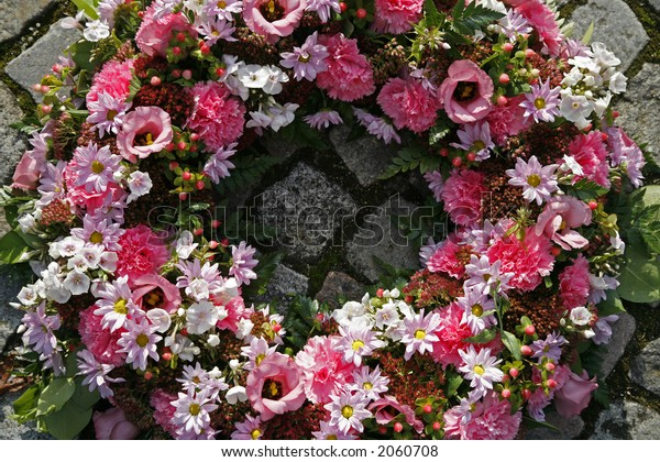 Pink garland on grave.