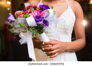 Pink Gerbera handtied bouquet held by teenage girl for senior prom