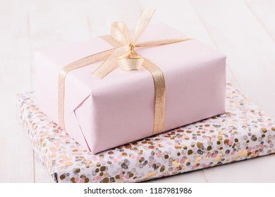Pink Gift Box On Wood Boards