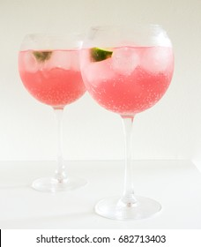 Pink Gin and Tonics with limes