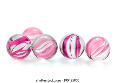 Pink, glass marbles isolated on white background