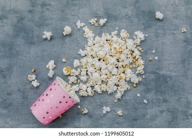 pink glass with pop corn top view