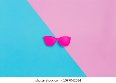 Pink glasses on coroful background. Minimal concept. Creative concept. Hot Summer Vibes. Pop Art. Bright Sweet fashion Style. Vanilla Pastel Color
