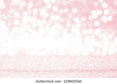 Pink glitter lights texture bokeh background Christmas. defocused