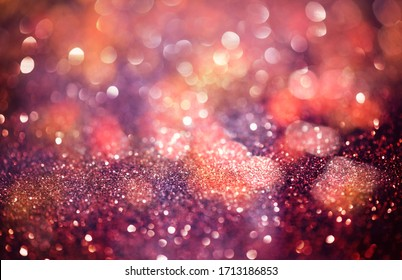 Pink glittering Christmas lights. Blurred abstract background