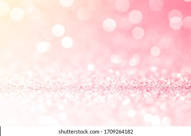 Pink gold, pink bokeh,circle abstract light background,Pink Gold shining lights,sparkling glittering Valentines day,women day or event lights romantic backdrop.Blurred abstract holiday background.