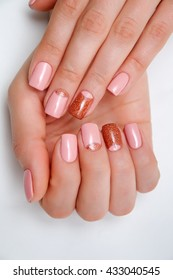 pink gold manicure on short square nails