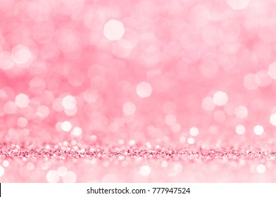 Pink gold, pink rose bokeh,circle abstract light background,Pink Gold shining lights, sparkling glittering Valentines day,women day,event lights romantic backdrop.Blurred abstract holiday background.