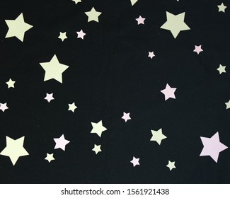 Pink and Gold Stars on a Black Background with small space for text, Social Media Marketing