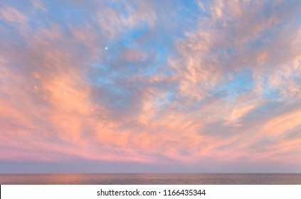 Pink and golden cloud background of the sky with clouds at sunset