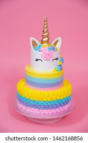 pink and golden unicorn cake