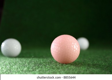 Pink golfballs with white friends waiting for continous play.