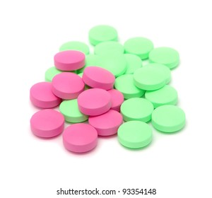 Pink and Green Pills Isolated on White Background