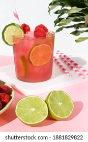 Pink and Green Raspberry Limeade with Pink and White Striped Straw