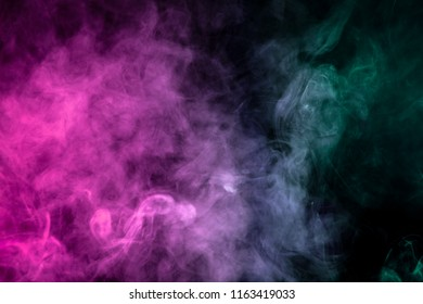 Pink, green and white  smoke on black background