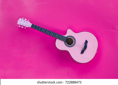 pink guitar on a pink background