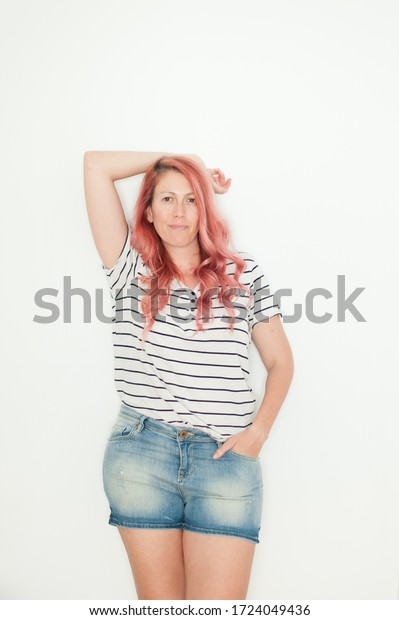 Pink haired woman portrait at home