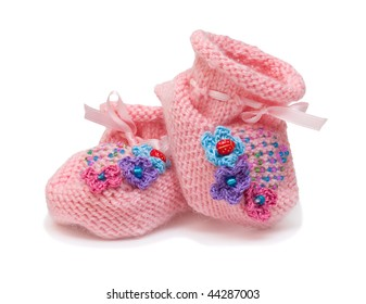 Pink handmade bootees for babies. Isolation.