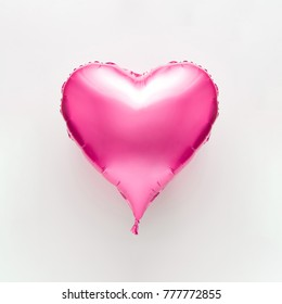 Pink heart balloon on bright background. Minimal love concept.