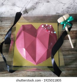pink heart geometric pinata cake