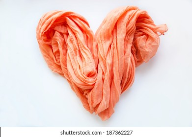 pink heart made ??of cloth on a white background