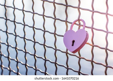 Pink heart. Metal lock Valentines day background. Concept of love, romantic relationship and fidelity. Copy space for your text
