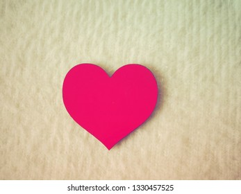 Pink heart on light background, safe heart