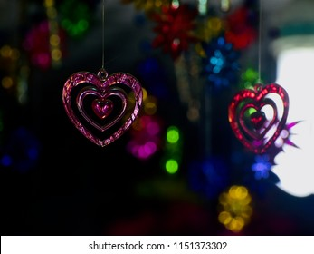 Pink heart shape hanging showpieces isolated unique blurry photo