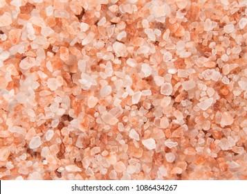 Pink Himalayan coarse grain salt texture. Top view.