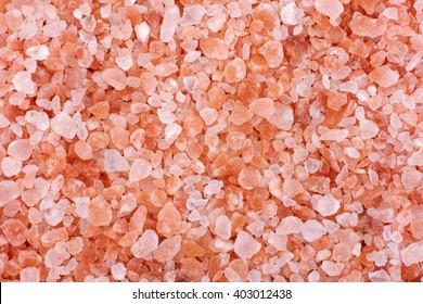 Pink himalayan salt background. Close up.