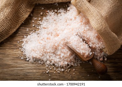 pink himalayan salt on a wooden table, top view