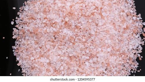 Pink Himalayan salt rotating. Big crystals