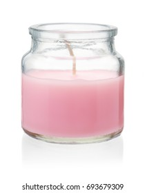 Pink homemade craft  candle in glass jar isolated on white