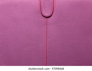 Pink horizontal with red stitched leather background