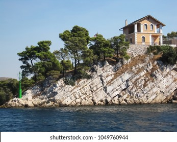 Pink house on the top of the cliff in Croatia