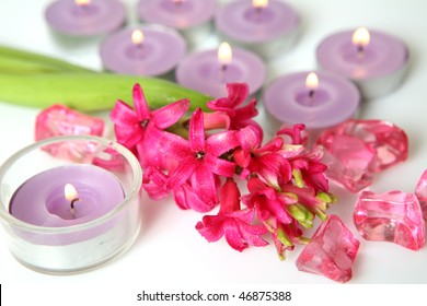 Pink hyacinth and candle
