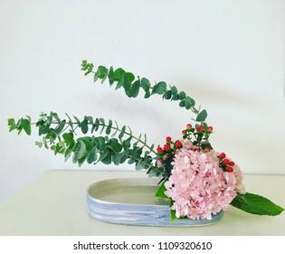 Pink hydrangeas with eucalyptus.Ikebana,Japanese style flower arrangement.