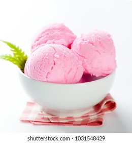 Pink ice cream in bowl on white background.