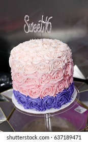 Pink Icing Birthday Cake On A Stand With Sparkly Sweet Sixteen Topper