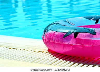 Pink inflatable round tube in a swimming pool