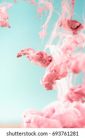 Pink ink in water, artistic shot, abstract background