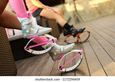 pink kangoo jumping boots at womans legs. fitness workout