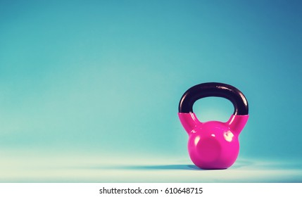 Pink kettlebell on a blue gradient background