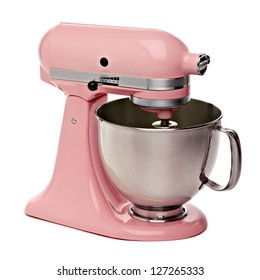 Pink kitchen or stand mixer isolated on white background including clipping path.