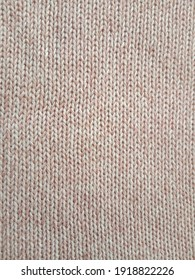 Pink knitting wool pattern background and texture