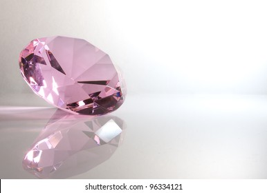Pink Kunzite Isolated on White Background with Reflection
