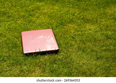 Pink laptop computer outside