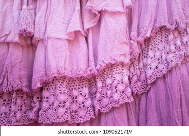 Pink layers of frilled gauze and lace background - selective focus