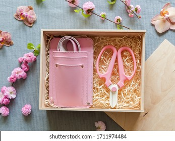 Pink leather florist holster and clippers in a gift wooden box - Shutterstock ID 1711974484